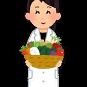 野菜を持つ白衣の女性